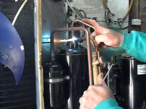 Aire acondicionado soldadura de compresor 3000 youtube for Compresor de aire acondicionado
