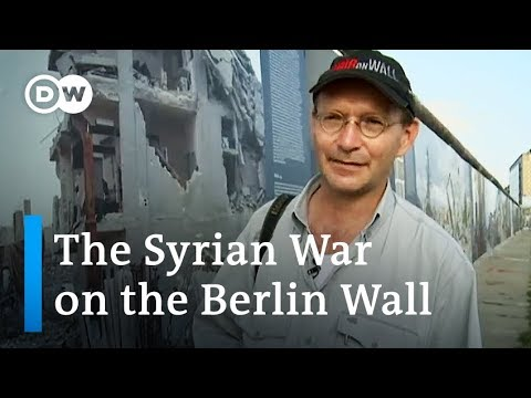 Syrian war images appear on Berlin Wall | DW News