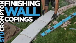 Finishing copings on a wall - bricklaying