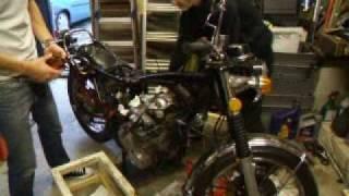 honda cb500 four lifting the spare engine into the frame