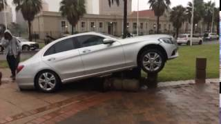 Durban Mercedes driver crash lands car on concrete bollard