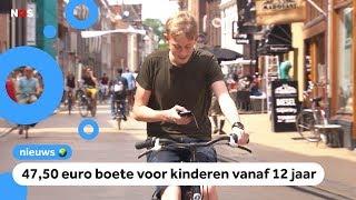 Met je mobieltje op de fiets? Vanaf nu krijg je een boete