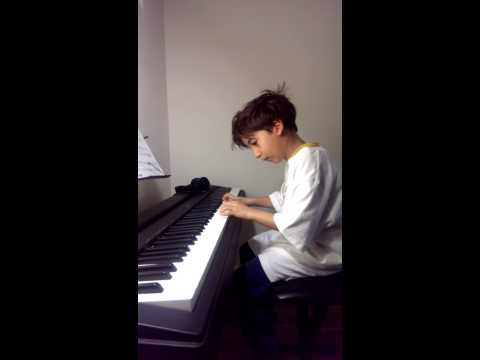 "Ashot's 7-year-old student Michael K. plays "" The Entertainer"""