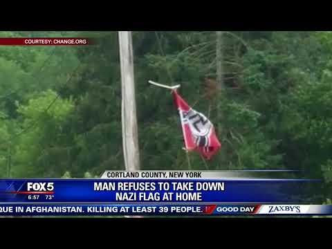 Man refuses to take Nazi flag down