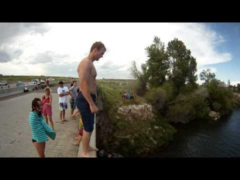 Jumping at Monkey Rock/Bridge by Brent McDowell