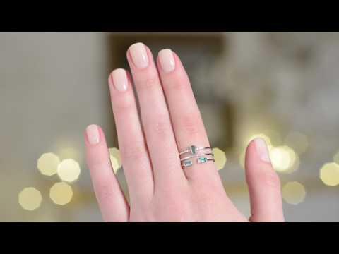 Стильный дизайн кольца с изумрудами и бриллиантами