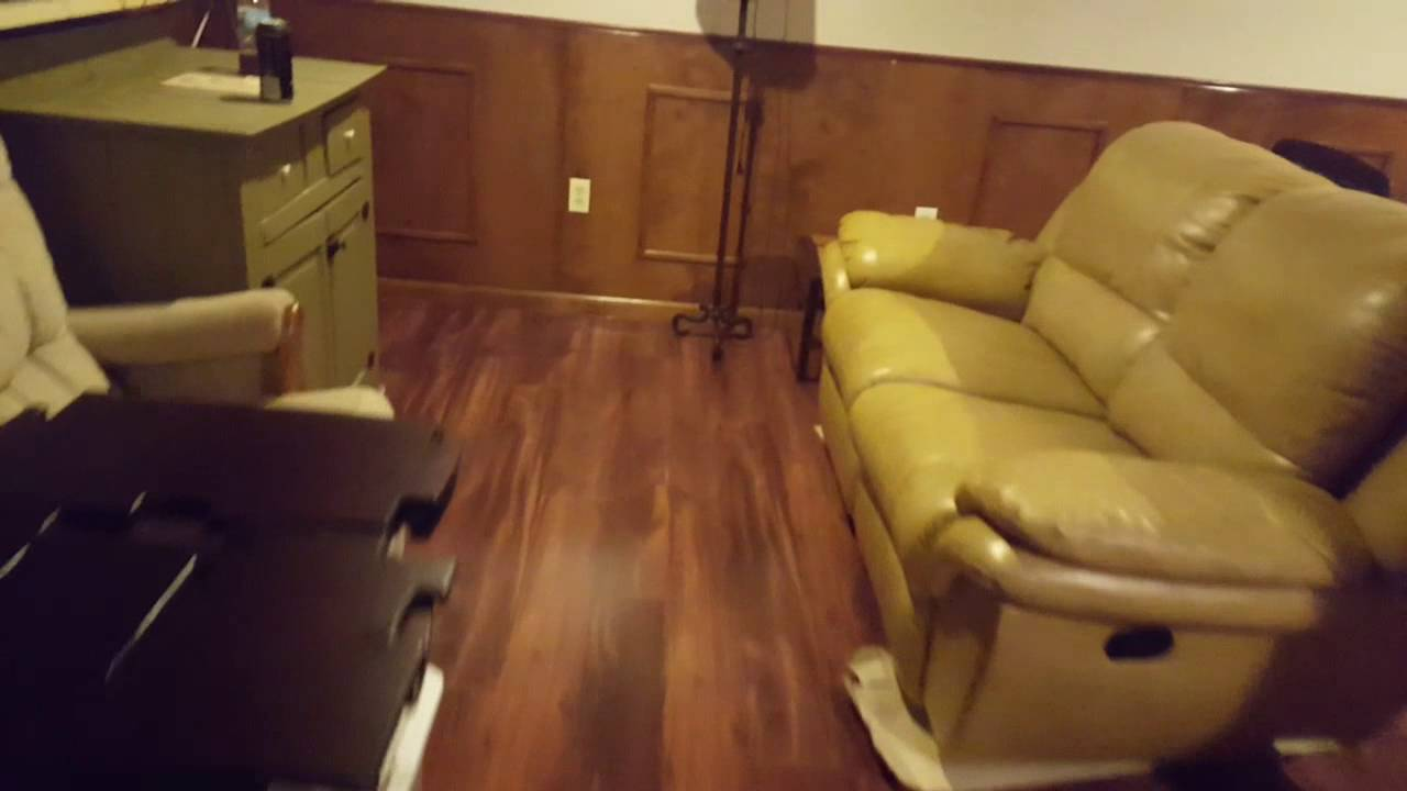 LAMINATE FLOORING BASEMENT TRANSFORMATION