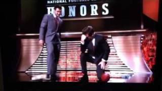 Tim tebow showing alec baldwin how to