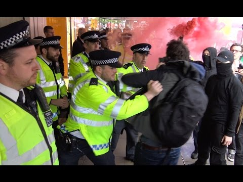 Scuffles with police & scared shoppers at London Topshop Protest
