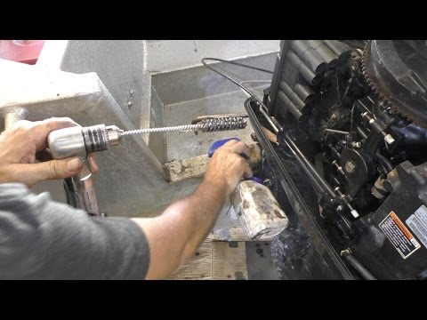 Cleaning an outboard tilt tube