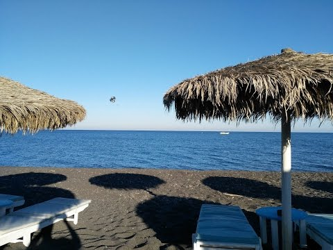 Waves, beaches, boats, planes and roads of Santorini, Greece