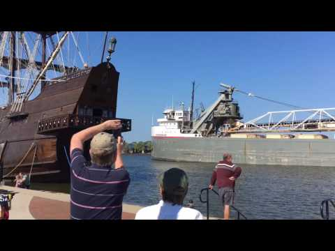 620-foot freighter cruises past Spanish, Viking tall ships