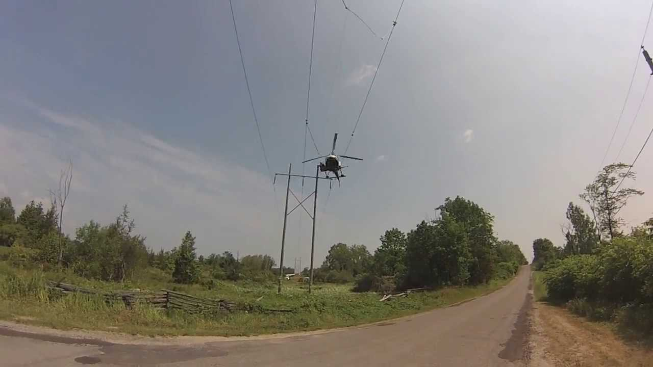 helicopter rescue man from telephone pole