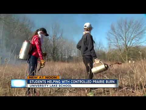 University Lake School students help with controlled prairie burn