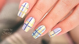 Suzie creates a cute variation of a plaid nail art design using nai...