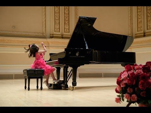 Emmie Guo (8) performs at Carnegie's Stern Auditorium Perelman Stage