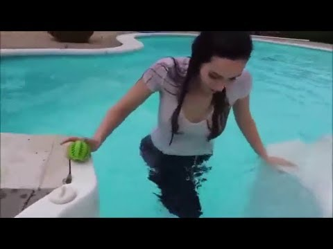 Girl gets into pool clothes on