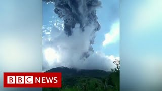 Thousands flee poisonous gas after volcano erupts - BBC News