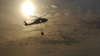 Oklahoma  grassfire  Feb 12,2017  Natl Guard Heli water drop by Daniel Bottoms(Feb 2017 grassfire filmed from home in south rural Oklahoma City. Numerous Oklahoma fire departments and the Air National Guard saved our homes., 2017-02-13T03:47:12.000Z)