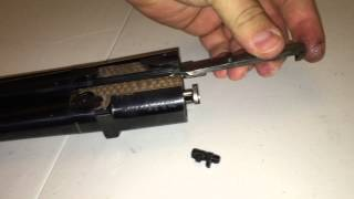 Removing the ejector on a Beretta 692 Shotgun