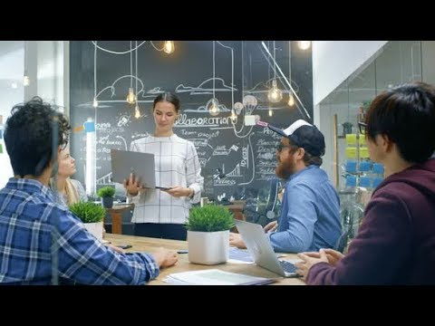 Beautiful Woman Spokesperson Shows Laptop with Infographics Display Great Results   Stock Footage -