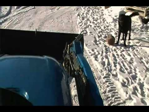 ls tractor plowing snow