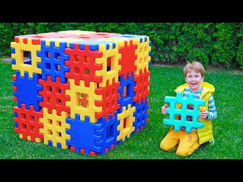 Eli Constructs From Waffle Block Toy With Mom And Playing Big Ball
