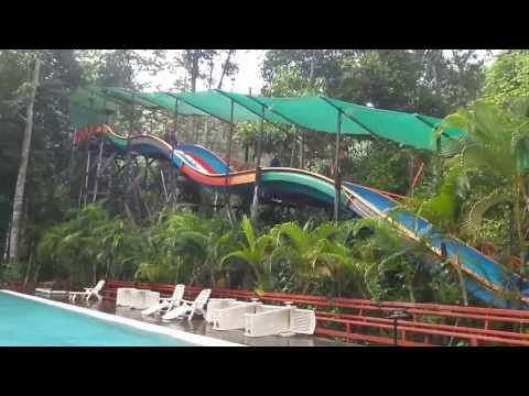 Fun on the water slides at Borneo Tropical Rainforest Resort, Miri