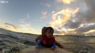 father takes son out surfing for the first time