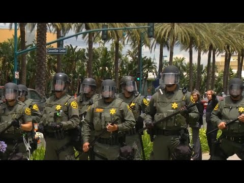 Police arrest protesters at Donald Trump rally in California