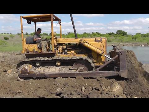 CAT D6 Pushing Dirt - YouTube