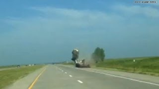 Caught on camera: SUV flies over a truck!!