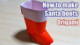 Origami. The art of folding paper. Santa boots