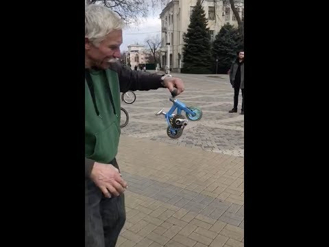 Guy rides the Smallest Bike