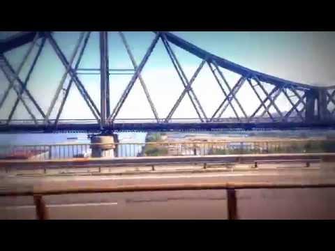 Train ride at bridge over river at summer day 2014. Danube - Cernavodă (Romania)
