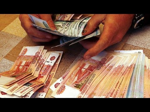 Kazakhstan's currency plunges after central bank abandons USD peg