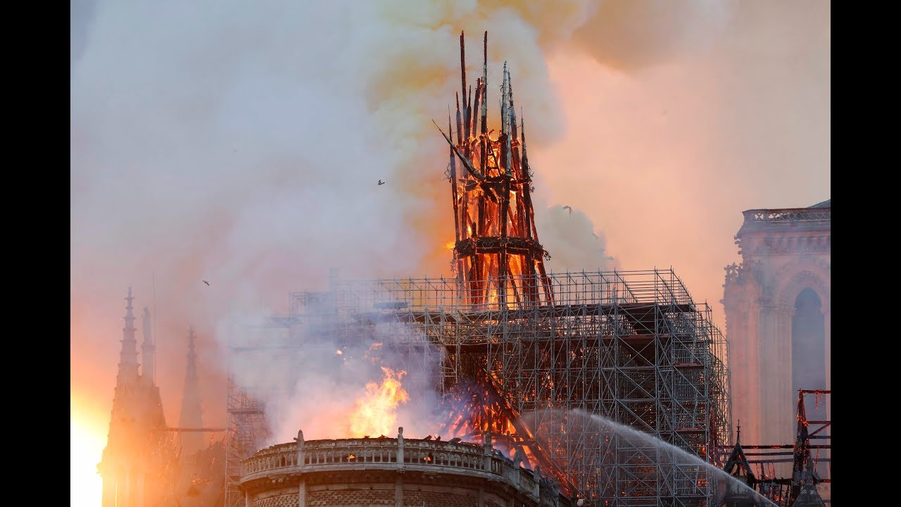 Paris is disfigured': Tears and shock as Notre Dame burns