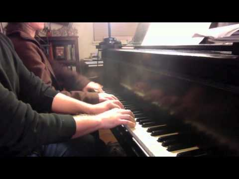 Beginning adult piano student plays duet with teacher