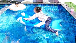 Misol ride whale in the pool