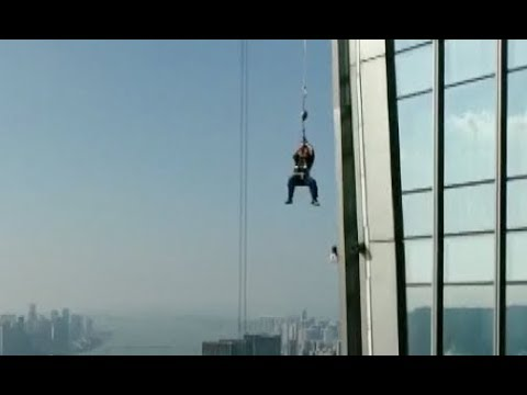 Window Cleaners Rescued from 57th Floor in Central China