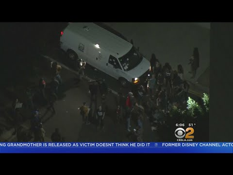 Protesters Try To Stop Homeland Security Van