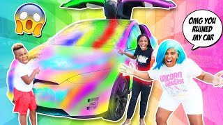 WE SPRAY PAINTED OUR MOMS TESLA (BAD IDEA)