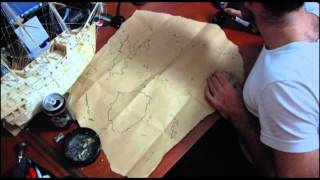 Drawing a map of the Fiji Archipelago with a quill