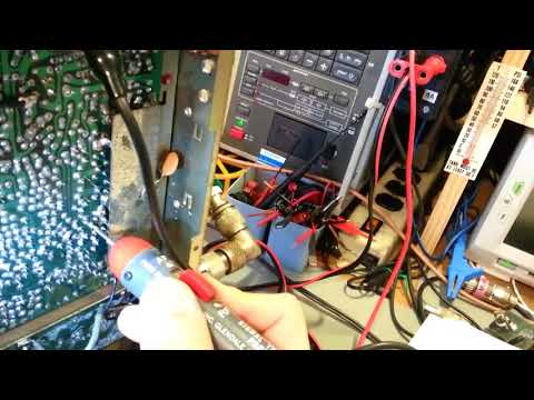 Troubleshooting static crash noise in a CB radio with a vintage tube type signal tracer.