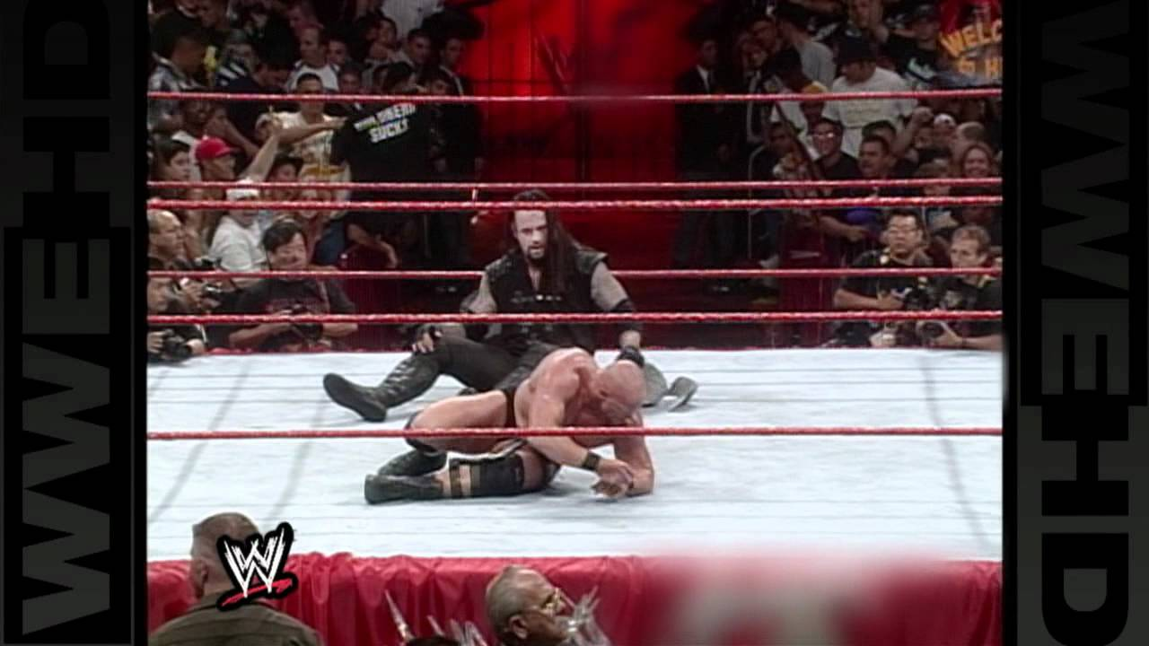 """""""Stone Cold""""  defends the WWE Title against The Undertaker"""