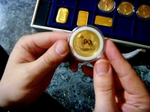 COLLECTION OF LARGE GOLD BULLION COINS AND BARS