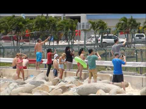 St.Maarten Airport Jet Blast!! Watch the girl with the green floaty!