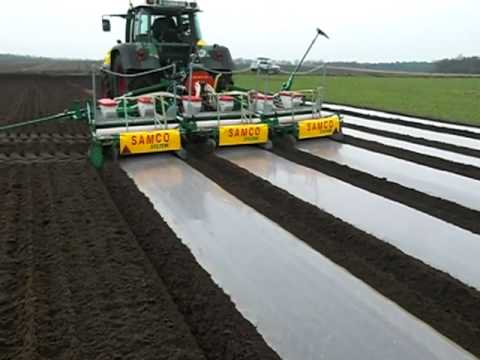 samco maize drill in germany laying degradable plastic mulch march 2009