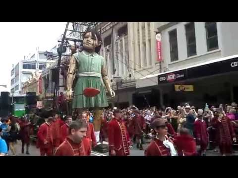 giant girl walks the streets of perth