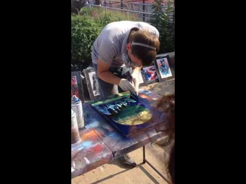 Amazing Coney Island street artist creates impressive art with paper and spray paint